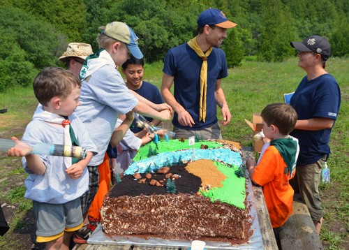 Scouts enjoy core samples from a geological cake.