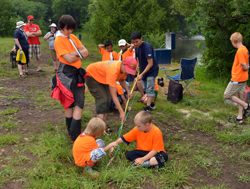 Scouts pump water from the Eramosa River.