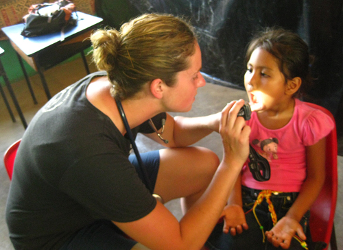 Kelly Ogilvie examines a young patient