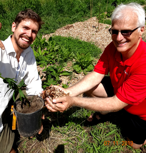 Paul Wartman, left, with one of his advisers, Prof. Ralph Martin, who holds the Loblaw Chair in Sustainable Food Production. Wartman took the photo himself and won first prize in last year's Graduate Studies Photography Competition.