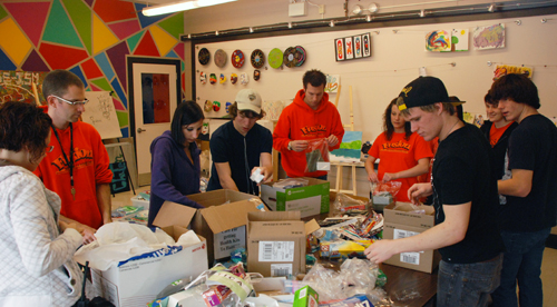 Fusion volunteers and students pack kits destined for Haiti.