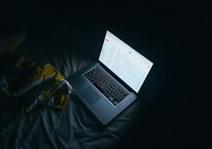Laptop in the dark, cyberbulling research by University of Guelph professor Ryan Broll.