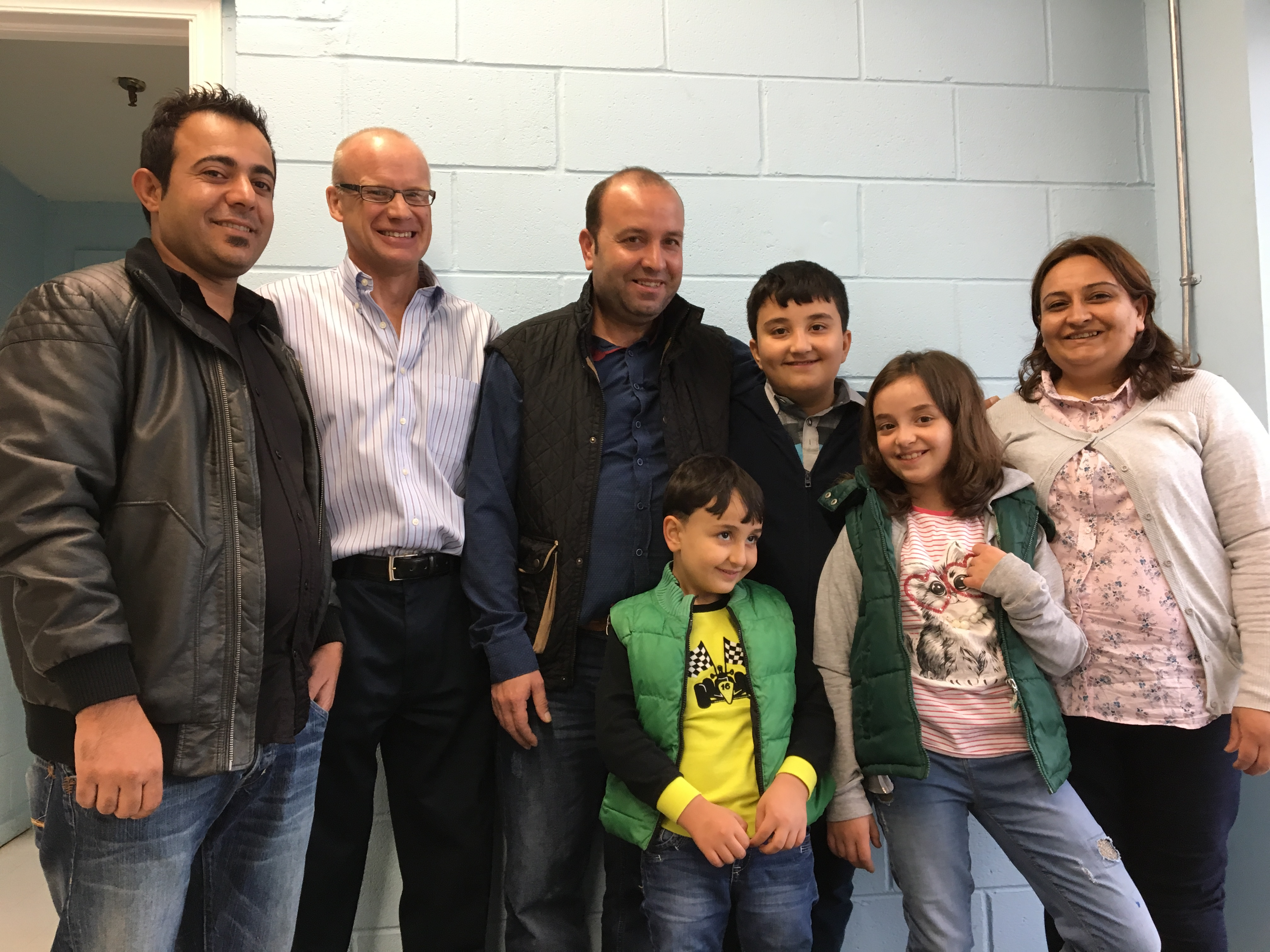 From left: Interpreter John Jowin, David Hobson, Halil Dudu, his children Muhammed, 7; Azad, 11; and Simaf, 9; and his wife Emine