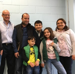 David Hobson at left with Halil Dudu, his wife Emine,  11-year-old son Azad,   nine-year-old daughter Simaf, and  Muhammed, age seven