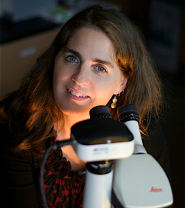 Prof. Nina Jones at a microscope