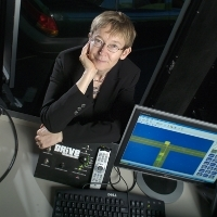 head shot of Prof. Lana Trick in front of a computer screen