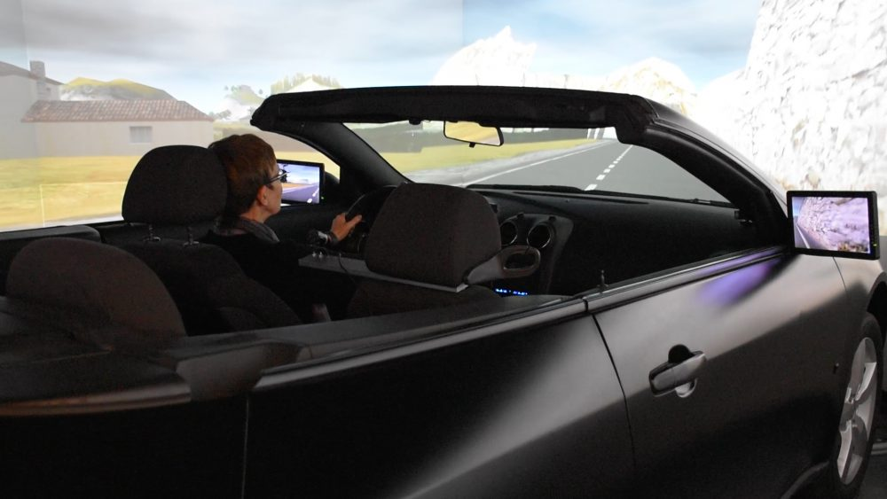 Prof Lana Trick driving in the drive lab simulator