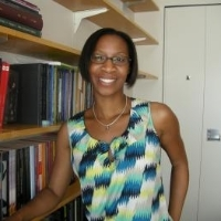 Prof Tamara Small standing in her office