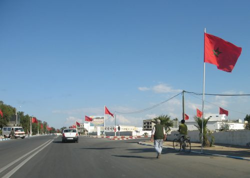 Moroccan flags in honor of King Mohammed VI (photo by Pierre Metivier via Flickr)