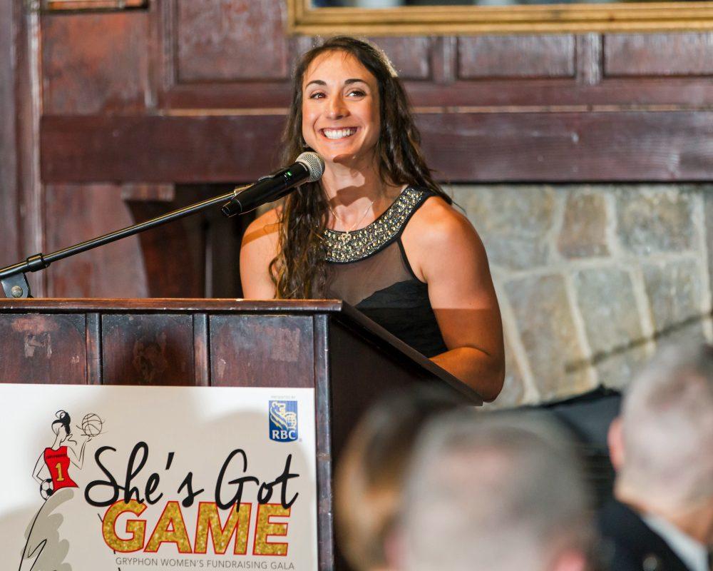 Athlete speaking at podium during She's Got Game gala