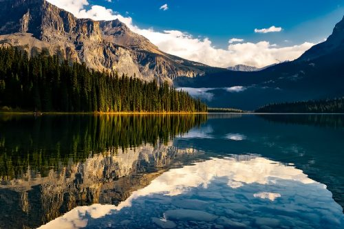 Mountains and sky reflected in glassy water