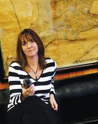 Prof Myrna Dawson sitting on chair