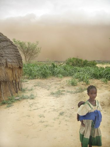 An adolescent girl holding a baby in Niger