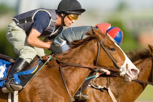 photo of jockey riding a racehorse