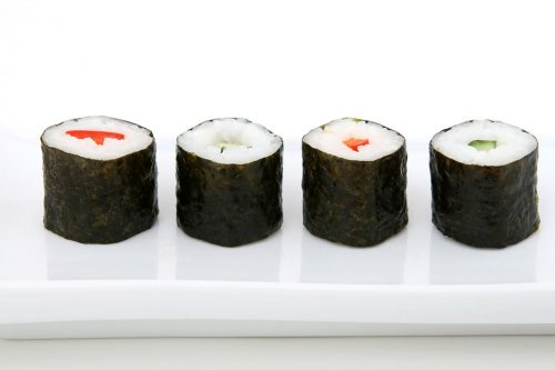 sushi maki with salmon on a plate