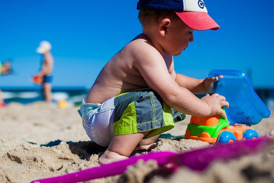 little boy at the beach playing