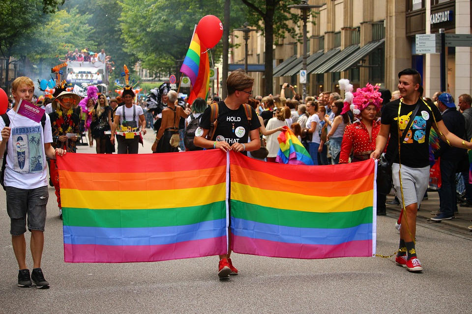 Pride Day marchers with rainbow flag