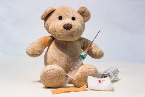 teddy bear and needle with vaccine kit