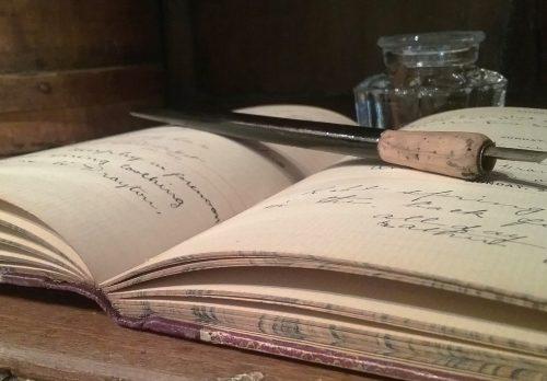 Old pen in book