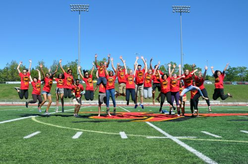 Students jump on the Gryphons football field