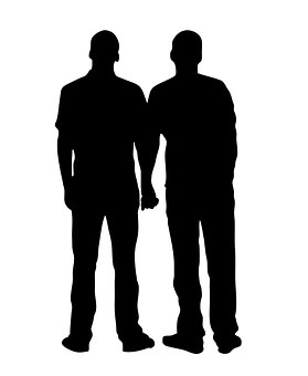 silhouette of two men holding hands