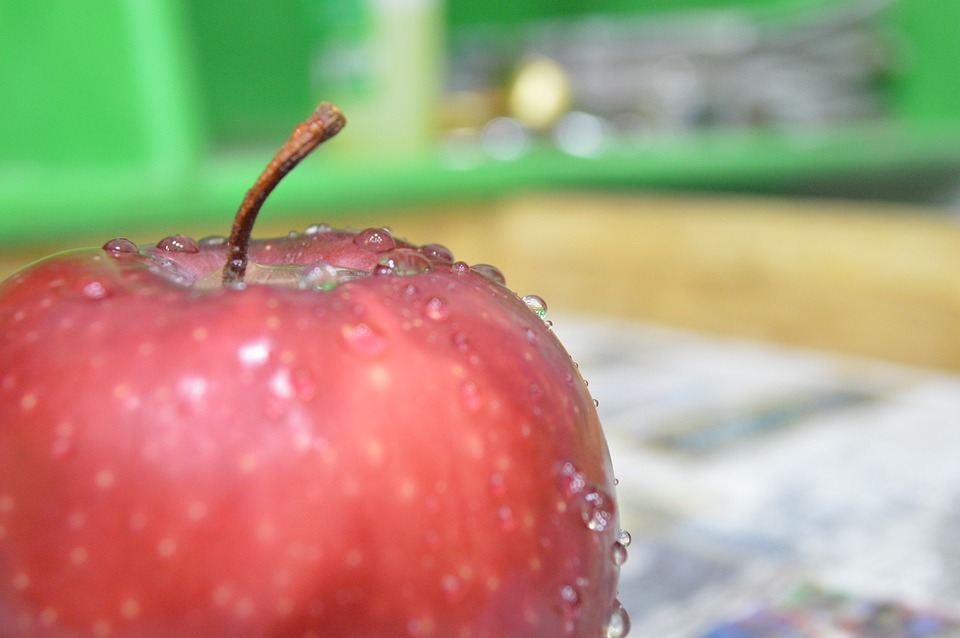 dewy apple sitting on a desk