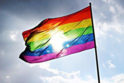 pride rainbow flag with sun shining through