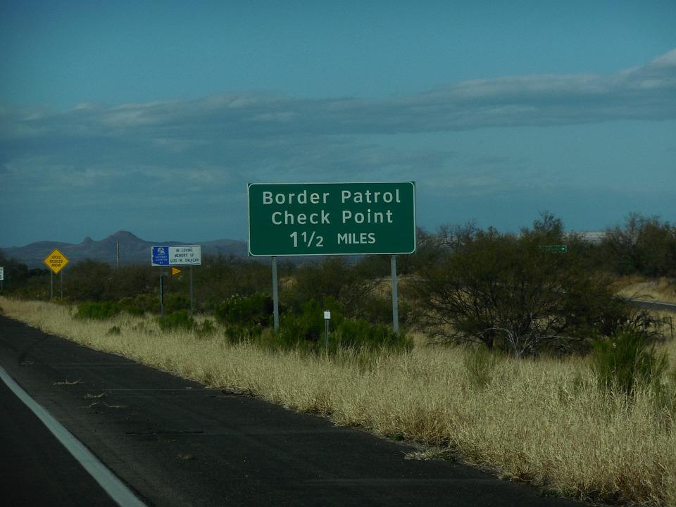 border patrol sign near border of US and Mexico