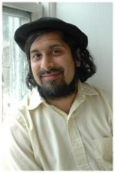 photo of Prof. Ajay Heble sitting next to a window