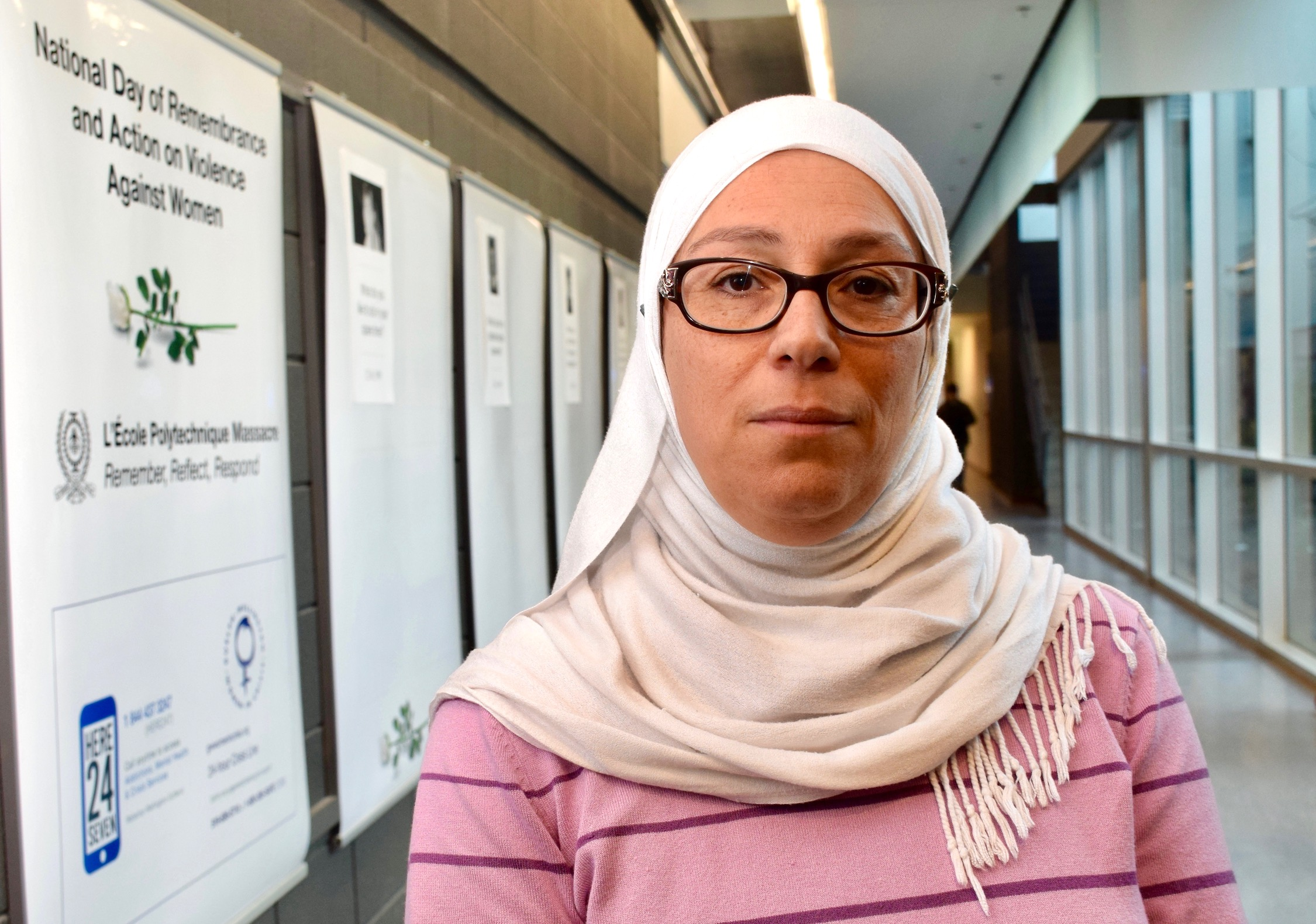 Engineering professor Sosa Moussa wearing a hijab and standing in Thornbrough Building hallway