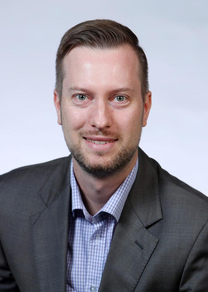 headshot of Prof. Simon Simogyi