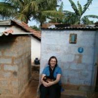 photo of Prof. Elizabeth Finnis sitting against a wall