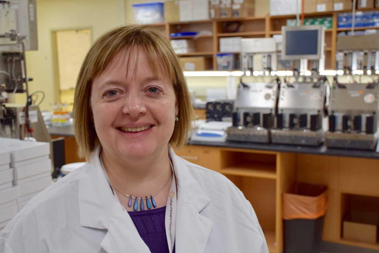 photo of Prof. Emma Allen-Vercoe standing in her lab