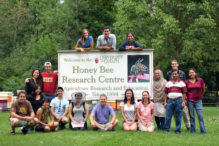 Honey Bee Research Centre team with sign