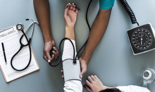 photo of a women's arm with a blood pressure cuff around it