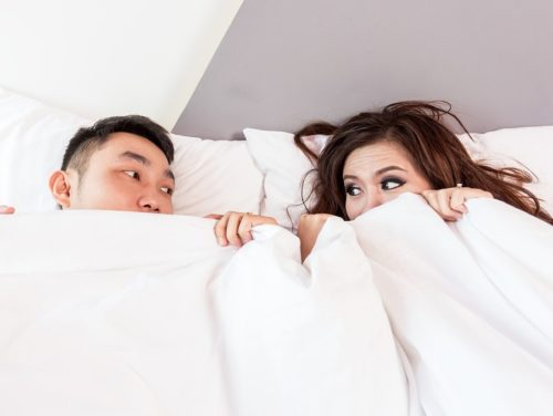a photo of a couple in bed
