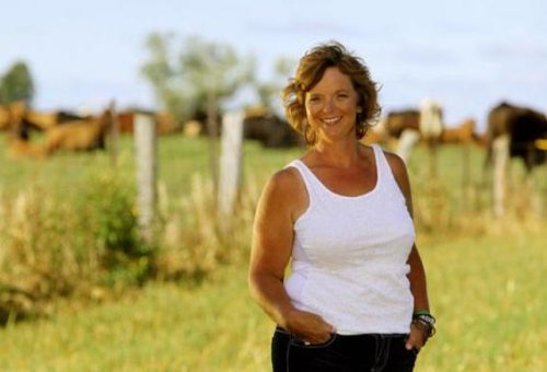 a photo of Kim Jo Bliss on her cattle farm