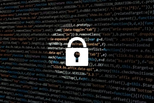 image of a lock with computer coding in the background
