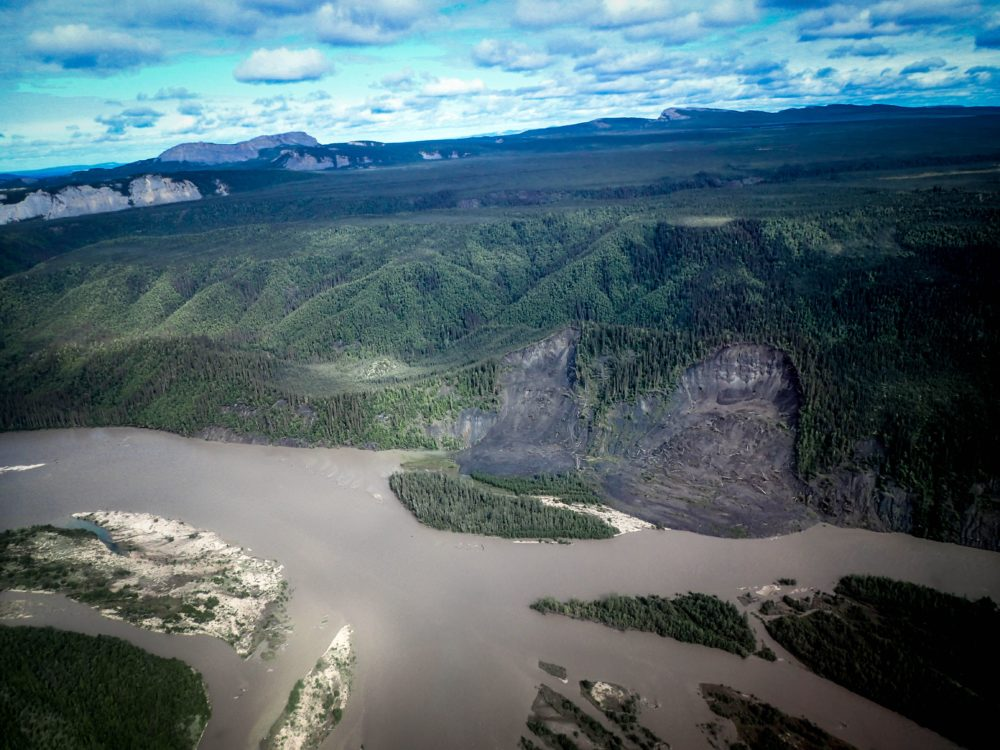 An aerial view of a permafrost landslide over a river