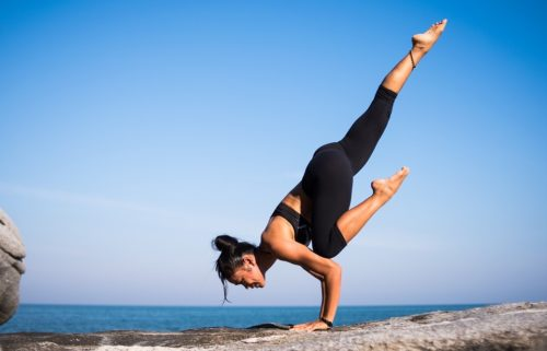 A photo of a woman performing yoga wearing leggings