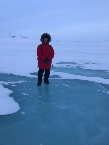 photo of Alex Borisenko standing on ice in the Arctic