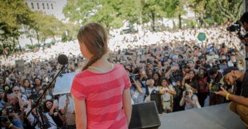 Greta Thunberg speaks before a crowd