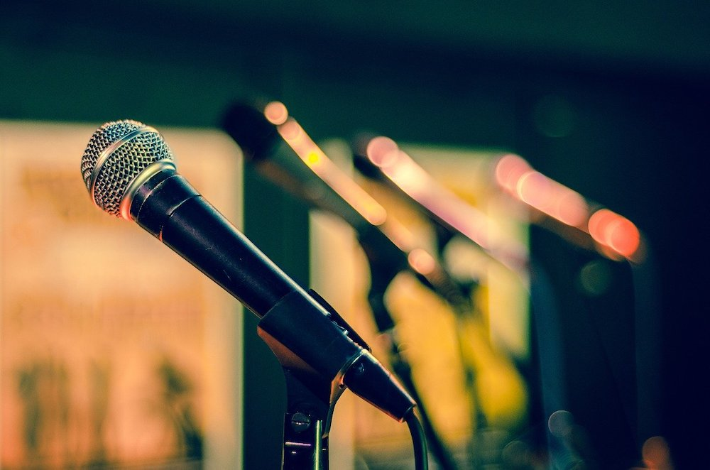 A row of microphones is shown.