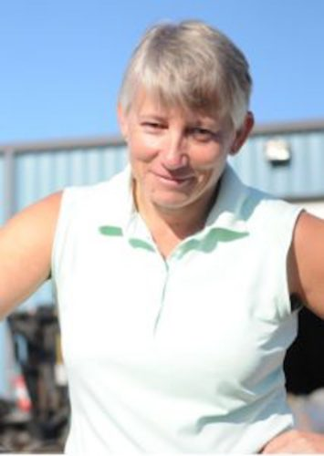 Woman in sleeveless top, short grey hair