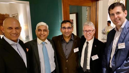 Five men smiling following formal talks