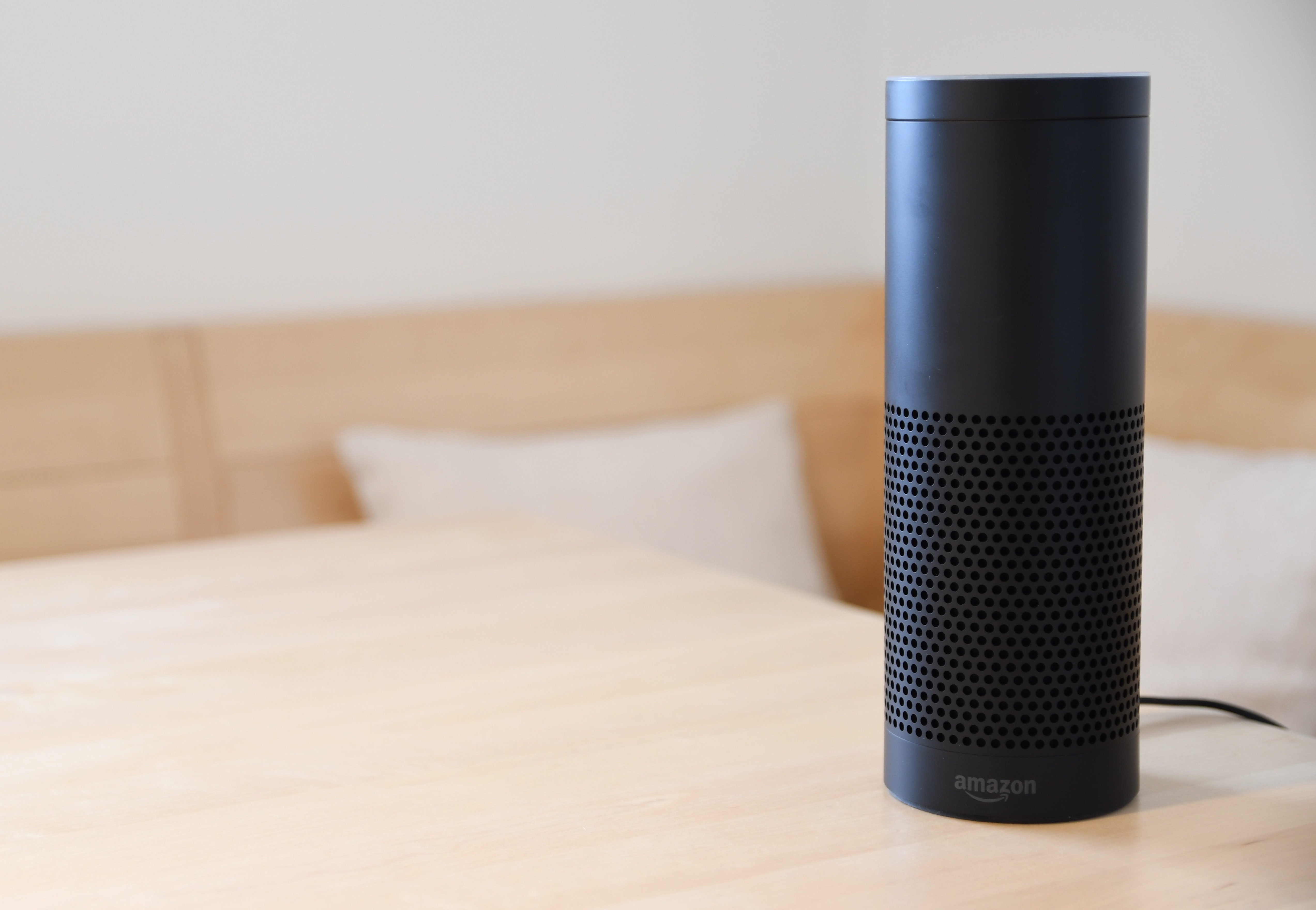 An Amazon Echo speaker sits on a table