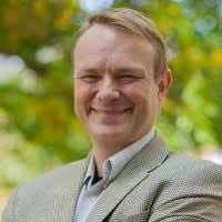 A headshot photo of Dr. Evan Fraser