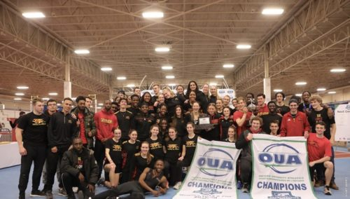 Crowd of victorious track and field athletes