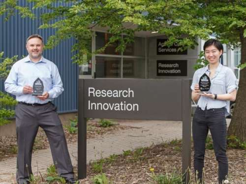 Chris Grainger of Harvest Genomics and Jane Ong of NeopPhoto Foods stand outside the Research Innovation Office