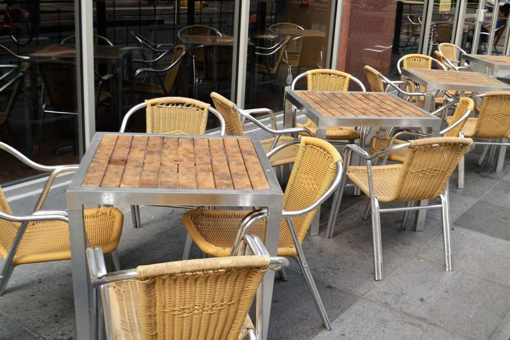 Empty restaurant patio tables and chairs